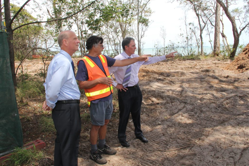 Councillor Rolf Light, Toogoom resident Martin Cooper and Mayor Gerard O'Connell check the progress of work on the Toogoom seawall.