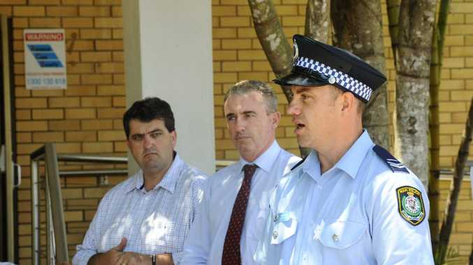 Mayor Richie Williamson and Member for Page Kevin Hogan listen on as Coffs Clarence Command domestic violence liaison officer, Senior Constable Steven Pope addresses the crowd at the White Ribbon Day event in Grafton. Photo JoJo Newby / The Daily Examiner