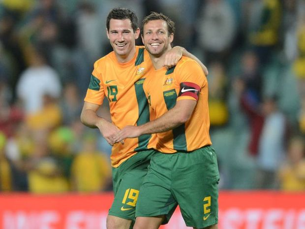 Australia's Lucas Neill and Ryan McGowan after their win over Costa Rica during the international friendly match between Australia and Costa Rica at Allianz Stadium in Sydney, Tuesday, Nov. 19, 2013.