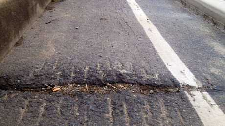 Cyclists have to contend with cracking bitumen at Vines Creek on Harbour Rd.