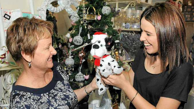 Store owner Kerri Ross helps customer Keely Clancy find the perfect items for Christmas.
