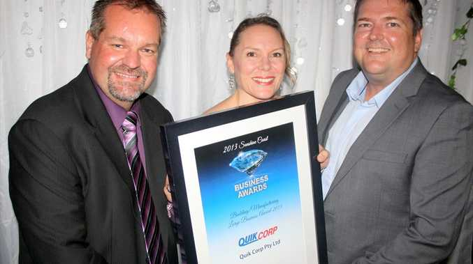 Andrew Geue, Jackie Clarke and Chris Coren of Quik Corp, winners of the Building/Manufacturing Large Business Award at 2013 Sunshine Coast Business Awards.