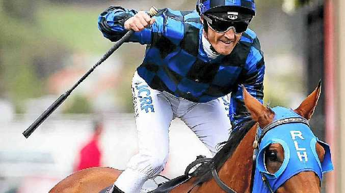 TOP EFFORT: Damian Browne celebrates after riding Buffering to victory in VRC Sprint Classic at Flemington.