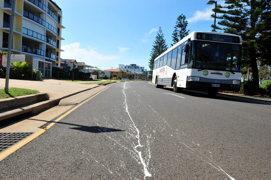 WHITE LINES: A messy line of paint graces the Esplanade on Bargara's foreshore. Photo: Max Fleet / NewsMail