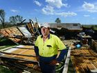 OPTIMISTIC: Michael McPhee of Rosewood in front of his shed which was flattened. His house was unroofed.