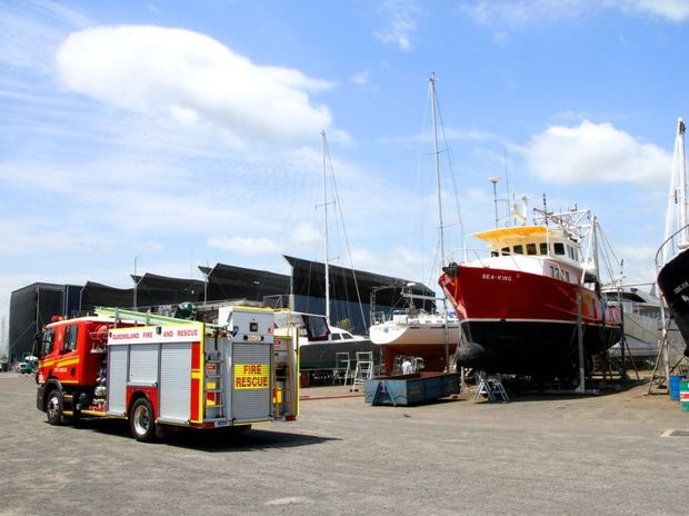 FIRE FIGHTERS: The fire brigade attended to a welding fire on a boat at the Bundaberg Port Marina dry dock. Photo: Zach Hogg / NewsMail