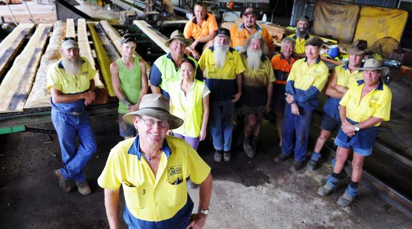 Manager Roger Fallon and workers at the Brooweena sawmill.