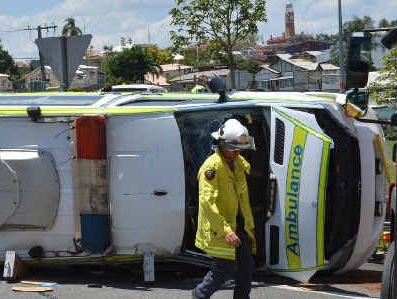 The scene of the accident at the corner of the Bruce Hwy and Monkland St yesterday, which left an ambulance on its side but nobody seriously injured.