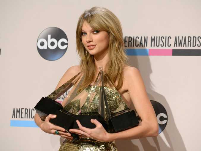 Taylor Swift with her American Music Awards haul.