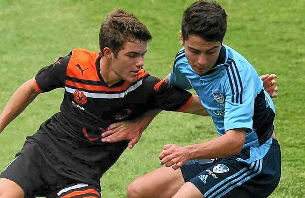 ROARING SUCCESS: Stanthorpe product Patrick Theodore (left) is the second-youngest player to make his debut for the Brisbane Roar.