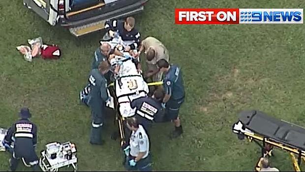 Paramedics rush to the aid of the tiger handler. Image: Nine News