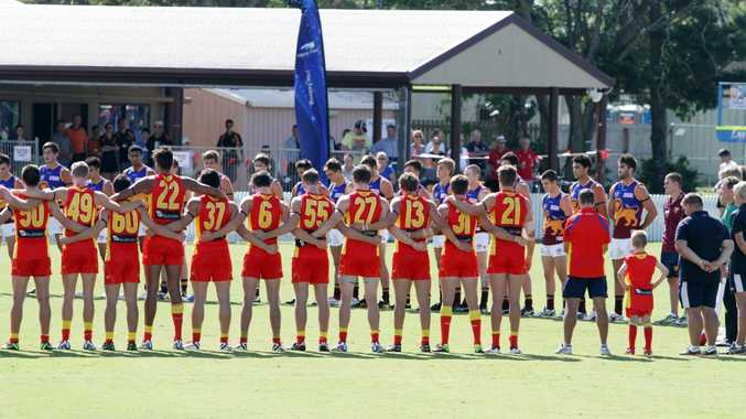 The Brisbane Lions and the Gold Coast Suns reserve teams bow their heads before their Anzac Day match at Harrup Park. AFLQ has extended its partnership with Harrup Park Country Club until 2026.