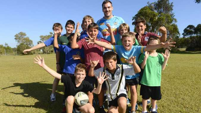 Former Yamba local and Gold Coast Titans player Luke Douglas with local kids at a Titans training session at Angourie Sports Complex. Photo Adam Hourigan / The Daily Examiner