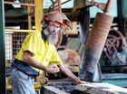 Bob Neilsen breaks down logs down at the Brooweena sawmill.