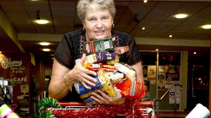 MORE NEEDED: Narelle Rankin, with an arm full of groceries for the Food For Farmers campaign, looks over the trolley at the Grafton District Services Club. Photo: Debrah Novak
