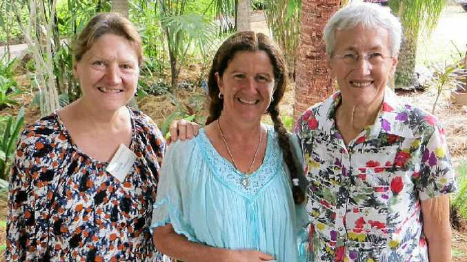 FITTING VENUE: Gayle Robinson, guest speaker Leonie Shanahan and Dell Kross in Dell's tropical palm garden at Gympie Horticultural Society's AGM.
