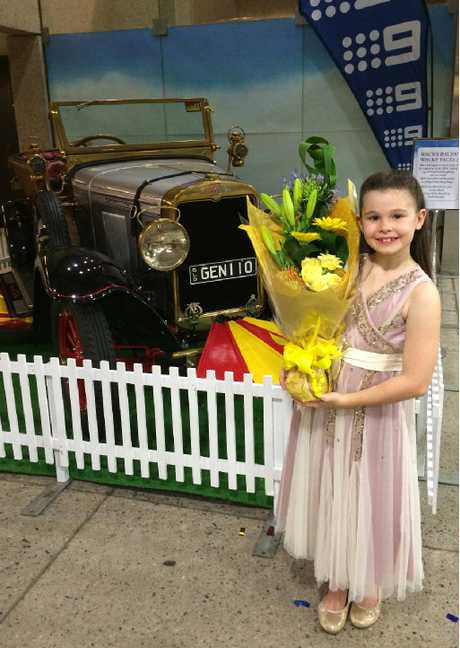 VROOM VROOM: Emma Cobb, who plays the lead character of Jemima in QPAC'S Chitty Chitty Bang Bang, holds her post-performance flowers.