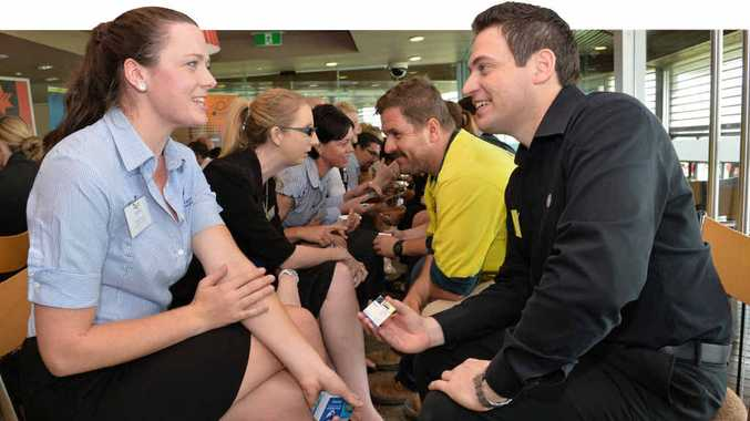 GET TALKING: Daydream Island Resort and Spa's regional sales executive Emma Scarrott and Mt Pleasant's Harvey World Travel manager Matthew Perre exchange business cards and get to know each other at the speed networking event held in Mackay yesterday.
