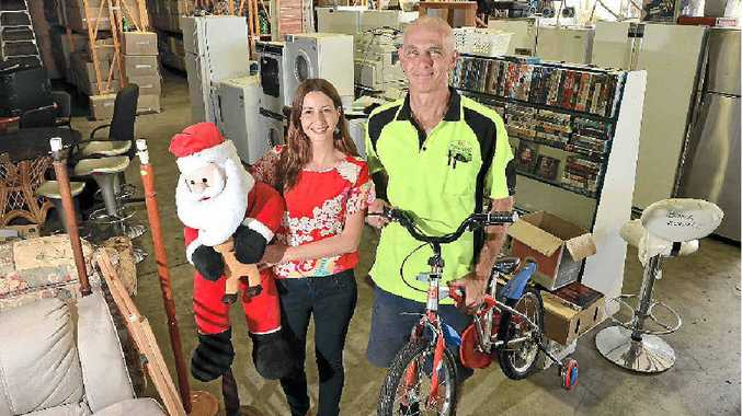 NEW DISTRIBUTION CENTRE: Bloomhill Cancer Help's Mervat Quirke and Russell Lindsay get stock ready at Kunda Park for the opening on Saturday.