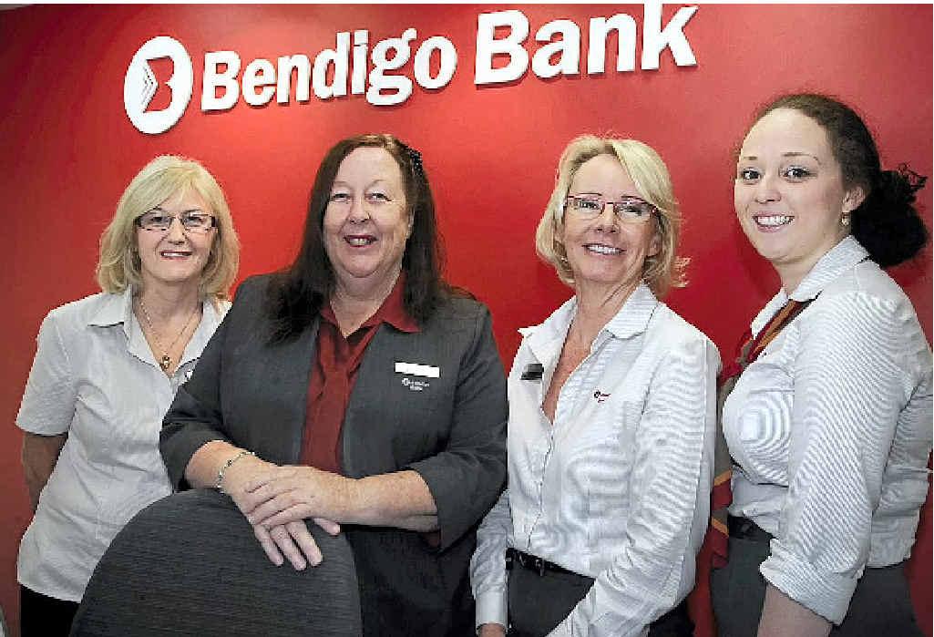 COMMUNITY SERVICE: Marcoola Community Bank branch manager Judy Blackall (second left) with Bendigo Bank staff Jane Morten, Julie Markillie and Lucie Loginow.