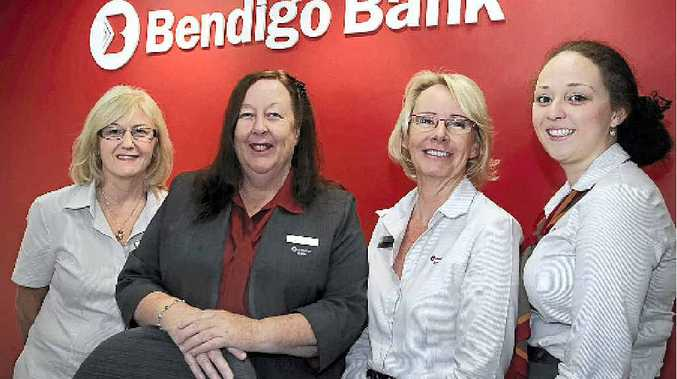 COMMUNITY SERVICE: Marcoola Community Bank branch manager Judy Blackall (second left) with Bendigo Bank staff Jane Morten, Julie Markillie and Lucie Loginow.