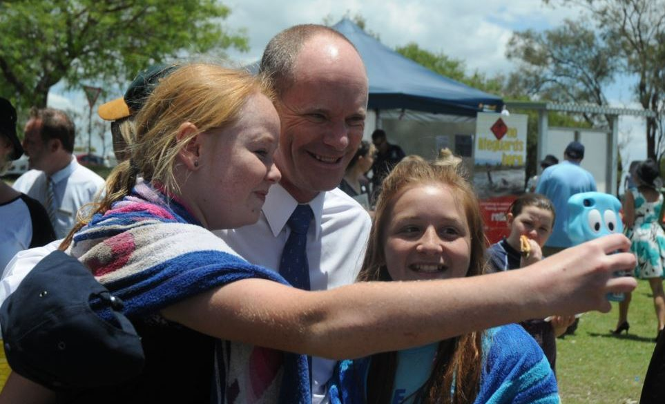 Claire Ward and Crystal Spanidis take a selfie with Premier Campbell Newman during his visit to Logan's Inlet yesterday to announce the approval of power boats on Wivenhoe Dam.
