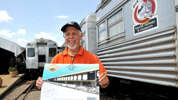 DownsSteam Tourist Railway and Museum volunteer Peter Eldridge shows off the planned design of the new-look Sunlander carriages which will be delivered early next year.
