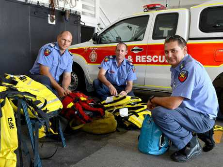 Swift-water rescue team members Mackenzie Rowe, Travis Norton and Neil Mellifont used their skills to save a man and woman at Boulder Creek.