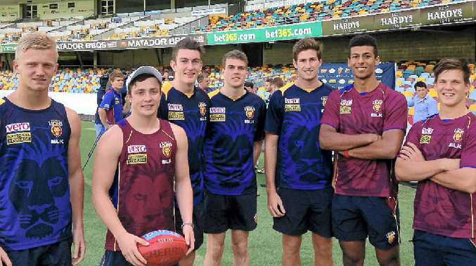NEW RECRUITS: Nicholas Robertson, Lewis Taylor, Daniel McStay, Jon Cutler, Jono Freeman, Archie Smith and Isaac Conway at the Gabba yesterday.