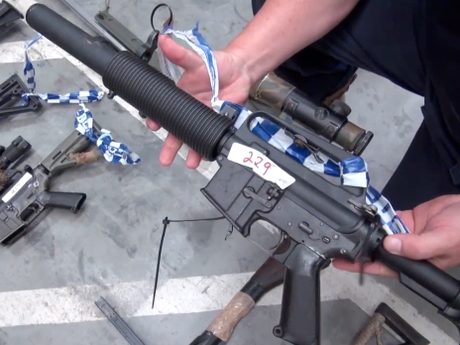 Police uncovered one of the largest holdings of illegal firearms, military style weapons, and ammunition in Queensland following an extended search of a property in Monto.
