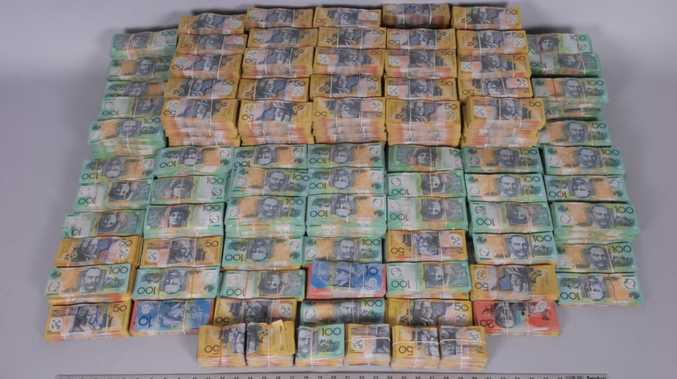 HUGE HAUL: Some of the cash seized during raids at Sanchez-Barrocal and Hererro-Calvo's homes after the drug bust. Photo Contributed