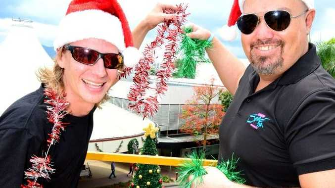 Banksy and Brad from Sea FM (Chris Banks and Brad Villiers) put a few of their own touches to the East Street Mall Christmas Tree, ahead of the CBD Christmas Fair. Photo Sharyn O'Neill / The Morning Bulletin