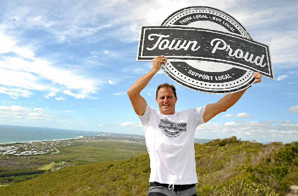 FLYING THE FLAG: Rugby league legend and Mooloolaba business owner Billy Moore supports APN's Town Proud campaign.