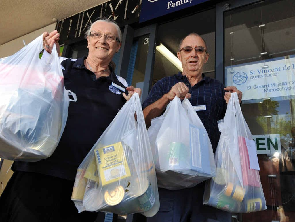 ON THE MOVE: June Chandler and Tony Powell from St Vincent de Paul in Maroochydore with food donations, have moved to 3/50 Aerodrome Rd, Maroochydore after their building was damaged in recent storms.