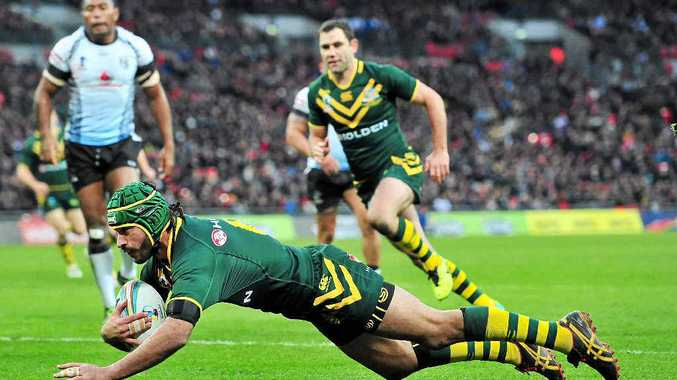 HARD MAN TO STOP: Australia's Johnathan Thurston scores against Fiji in the Rugby League World Cup semi-final last weekend.