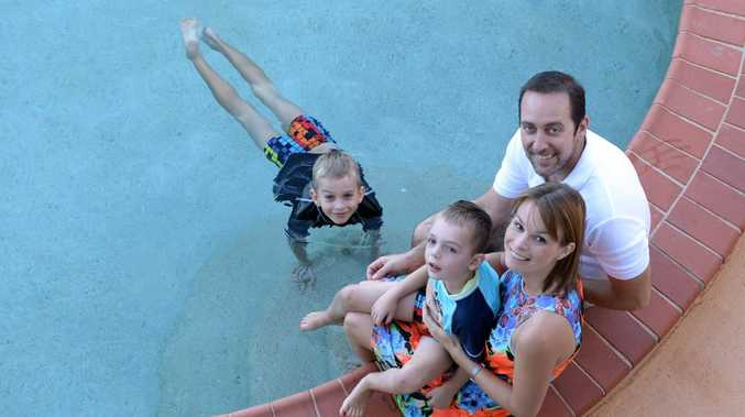 Liz and Anthony Sinclair with their sons (Back) Kyan (7) and (sitting in lap) Cooper (5). Liz is organising a 12 hour relay swim to raise money for Cooper who suffers a severe form of epilepsy called Dravet Syndrome. Photo: Chris Ison / The Morning Bulletin