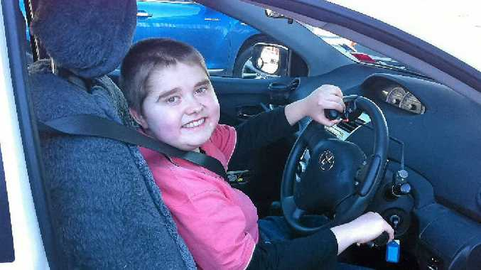 HIGH-BEAM GRIN: MacKinley Brisbane was thrilled after his first driving lesson.