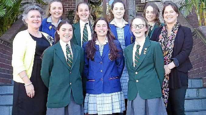 HELPING HANDS: Rebecca Pearce (rear left), Maison Levott, Bridget Lea and Lauren Aroyan. Vicki Evans (front left), Eliza Salvatori, Madeline Beaumont, Claire Hatchman, and Jessica Evans.