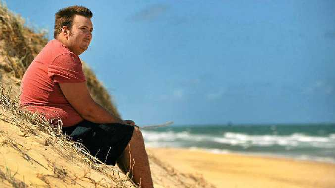 WAKE-UP CALL: Daniel Paul Kearney returns to the beach where he nearly drowned in a rip. He wants to find the people who helped save his life.