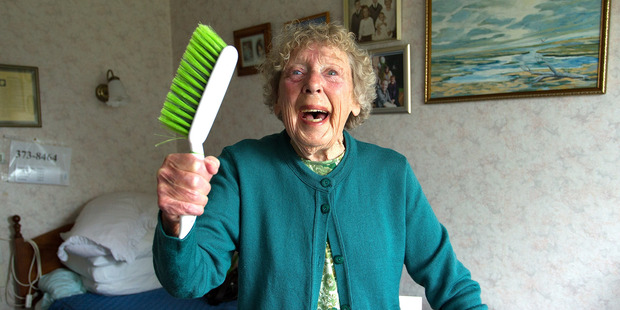 Christchurch great-grandmother Lois Kennedy, now 84, launched herself at her terrified neighbour's attacker with a heart brush.