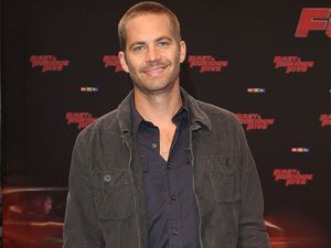 Two charged with stealing from Paul Walker death wreck