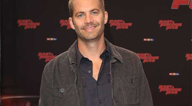 Two men have been charged with stealing from Paul Walker's death crash car and could face up to four and a half years in jail if convicted.