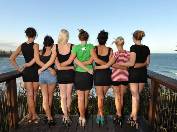 Eight girls from the Miss Sunshine Coast competition are protesting against the apparently under-age 17-year-old winner, and are facing away to hide their identities at Moffat Beach. Photo: Iain Curry / Sunshine Coast Daily