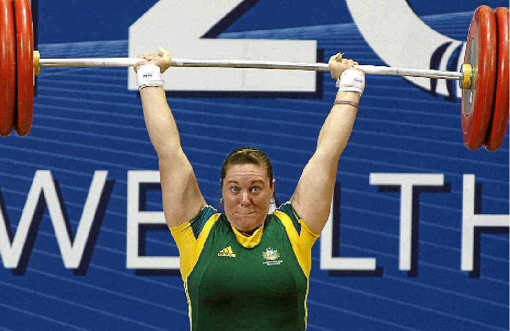 Deborah Acason attempts a lift in the women's 75+ kg category weightlifting at the Commonwealth Games in New Delhi in 2010 where she won bronze after winning gold in Melbourne four years earlier.