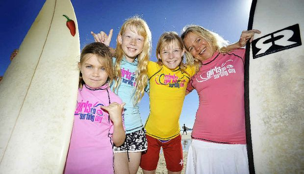COOL KIDS: Mahia Adams, 8, Courtney and Tayla Slater, 11 and surf coach Karin Ochsner getting ready for the Girls Go Surfing day next weekend. STORY PAGE 2