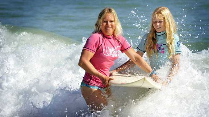 FUN IN THE SUN: Girls Go Surfing Day will give novices the chance to catch a wave.