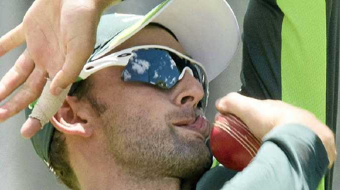 LICKING HIS LIPS: Australia's No.1 spinner, Nathan Lyon, bowls during a net session in Adelaide this week.