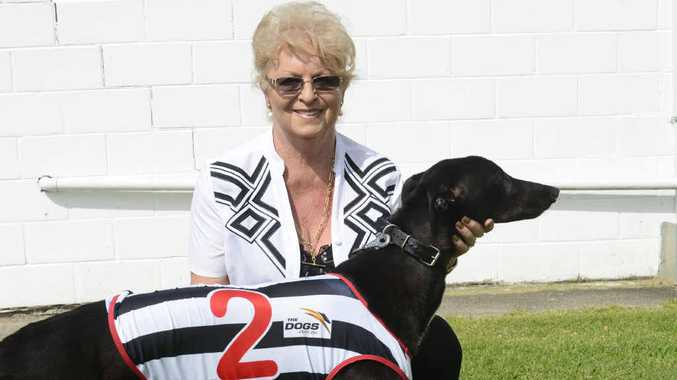 SALUTE: Dianne Hannon with her winning dog in race one, Billy's Shadow. Photo: Adam Hourigan