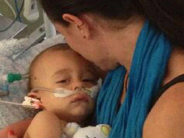EMOTIONAL MOMENT: Sarah Smith holds Finn in hospital.