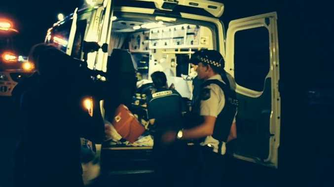 Ambulance officers load one of the people injured in a machete attack at a Park Avenue home last night.